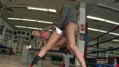 Boxer Nikkita Bellucci can't resist his coach and has anal sex near the ring