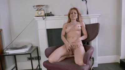 Big breasted Karolina sliding her hands towards wet cunt