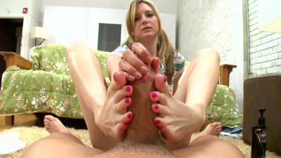 Kacey Jones tugging cock with her feet